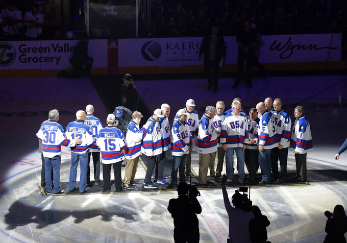 "Members of the gold medal 1980 ""Miracle on Ice"" U.S. Olympic hockey team are honored prior to an NHL hockey game between the Golden Knights and the Florida Panthers, Saturday, Feb. 22, 2020, in Las Vegas. (AP Photo/Marc Sanchez)"