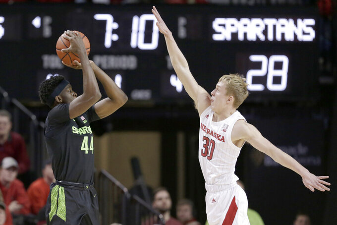 Michigan State's Gabe Brown (44) shoots against Nebraska's Charlie Easley (30) during the first half of an NCAA college basketball game in Lincoln, Neb., Thursday, Feb. 20, 2020. (AP Photo/Nati Harnik)