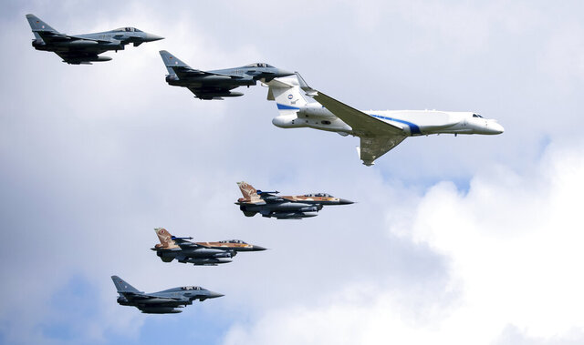 German air force Bundeswehr Eurofighters and an Israeli Air Force jets fly in formation over the Fuerstenfeldbruck airbase in commemoration of the 1972 Olympic Games assassination attempt in Fuerstenfeldbruck, Germany, Tuesday, Aug. 18, 2020. The attempt to rescue the hostages failed at the airbase in Fuerstenfeldbruck in 1972and the hostages perished. It is the Israeli Air Force's first time conducting joint air combat exercises in Germany. (Sven Hoppe/dpa via AP)