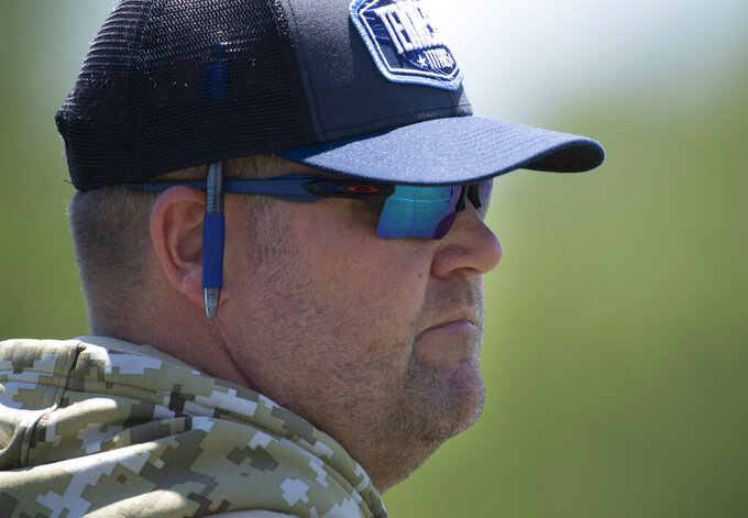 Tennessee Titans general manager Jon Robinson watches during NFL football minicamp Tuesday, June 15, 2021, in Nashville, Tenn. (George Walker IV/The Tennessean via AP, Pool)