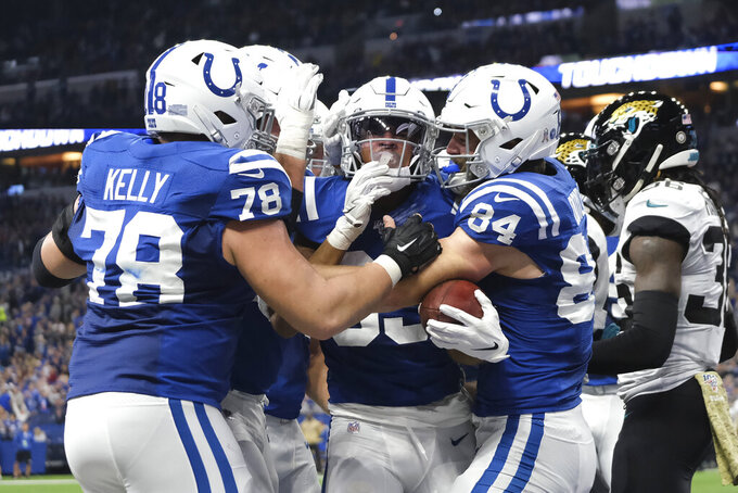 Indianapolis Colts' Marcus Johnson, middle, celebrates a touchdown reception during the second half of an NFL football game against the Jacksonville Jaguars, Sunday, Nov. 17, 2019, in Indianapolis. (AP Photo/AJ Mast)