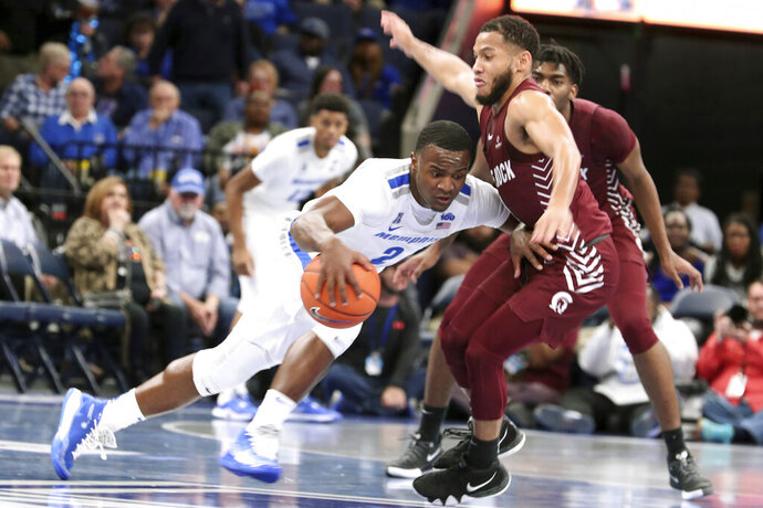 Memphis' Alex Lomax (2) tries to drive the ball past Little Rock's Markquis Nowell (1) during the first half of an NCAA college basketball game Wednesday, Nov. 20, 2019, in Memphis, Tenn. (AP Photo/Karen Pulfer Focht)