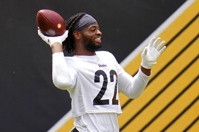 Pittsburgh Steelers running back and first round pick Najee Harris tosses a football during the team's NFL mini-camp football practice in Pittsburgh, Tuesday, June 15, 2021. (AP Photo/Gene J. Puskar)