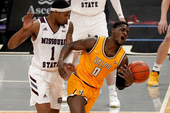 Valparaiso's Goodnews Kpegeol (0) loses control of the ball as Missouri State's Isiaih Mosley (1) watches during the first half of an NCAA college basketball game in the quarterfinal round of the Missouri Valley Conference men's tournament Friday, March 5, 2021, in St. Louis. (AP Photo/Jeff Roberson)
