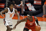 Maryland's guard Darryl Morsell (11) is pressured by Illinois guard Ayo Dosunmu (11) in the first half of an NCAA college basketball game Sunday, Jan. 10, 2021, in Champaign, Ill. (AP Photo/Holly Hart)