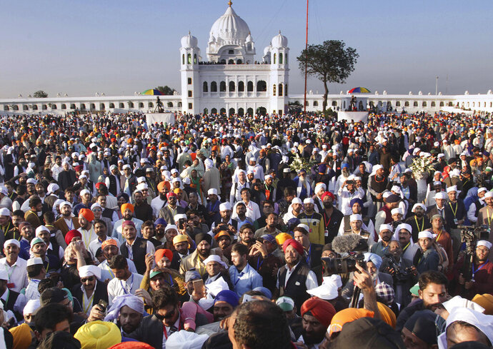 Sikh pilgrims visit the shrine of their spiritual leader Guru Nanak Dev, at Gurdwara Darbar Sahib in Kartarpur, Pakistan. Pakistan's prime minister Imran Khan has inaugurated a visa-free initiative that allows Sikh pilgrims from India to visit one of their holiest shrines. Khan opened the border corridor on Saturday as thousands of Indian pilgrims waited to visit the Kartarpur shrine. (AP Photo/K.M. Chaudary)