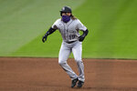 Colorado Rockies' Charlie Blackmon leads off from second base during the fifth inning of the team's baseball game against the Seattle Mariners on Saturday, Aug. 8, 2020, in Seattle. (AP Photo/Elaine Thompson)