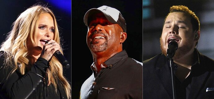 This combination photo shows Miranda Lambert performing at the 2017 CMA Music Festival in Nashville, Tenn. on June 8, 2017, from left,  Darius Rucker performing at the CMA Music Festival in Nashville, Tenn., on June 14, 2015 and Luke Combs performing at the 54th annual Academy of Country Music Awards in Las Vegas on April 7, 2019. CMT is saluting heroes on the frontline of the COVID-19 pandemic with a star filled TV special featuring Combs, Lambert, Rucker, Florida Georgia Line and others. (AP Photo)