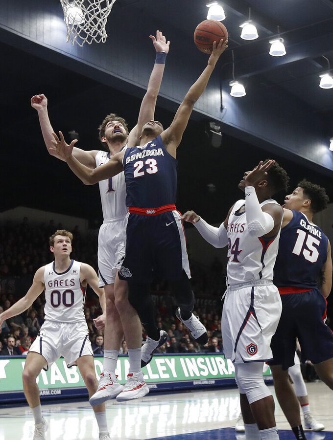 Gonzaga guard Zach Norvell Jr. (23) shoots in front of Saint Mary's center Jordan Hunter during the first half of an NCAA college basketball game in Moraga, Calif., Saturday, March 2, 2019. (AP Photo/Jeff Chiu)