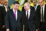 "FILE - In this June 5, 2019, file photo, Russian President Vladimir Putin, center right, and Chinese President Xi Jinping, center left, enter a hall for talks in the Kremlin in Moscow, Russia. Putin and Xi have developed strong personal ties helping bolster a ""strategic partnership"" between the two former Communist rivals. (AP Photo/Alexander Zemlianichenko, Pool, File)"