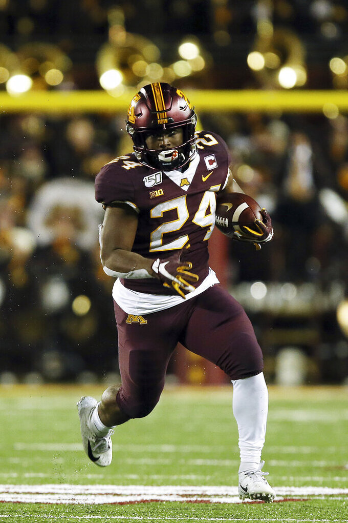 Minnesota running back Mohamed Ibrahim carries the ball downfield during the second half of an NCAA college football game against Nebraska, Saturday, Oct. 12, 2019, in Minneapolis. (AP Photo/Stacy Bengs)