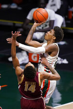 Miami guard Kameron McGusty shoots over Boston College forward Kamari Williams (14) during the second half of an NCAA college basketball game Friday, March 5, 2021, in Coral Gables, Fla. (AP Photo/Wilfredo Lee)