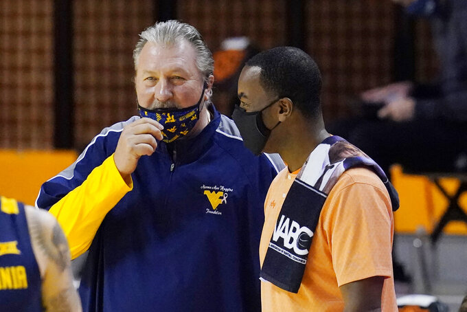 West Virginia head coach Bob Huggins, left, and Oklahoma State head coach Mike Boynton Jr., right, talk before their NCAA college basketball game Monday, Jan. 4, 2021, in Stillwater, Okla. (AP Photo/Sue Ogrocki)