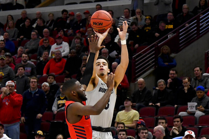 Colorado guard Maddox Daniels (3) shoots past Dayton guard Jalen Crutcher in the first half of an NCAA college basketball game, Saturday, Dec. 21, 2019, in Chicago. (AP Photo/Matt Marton)