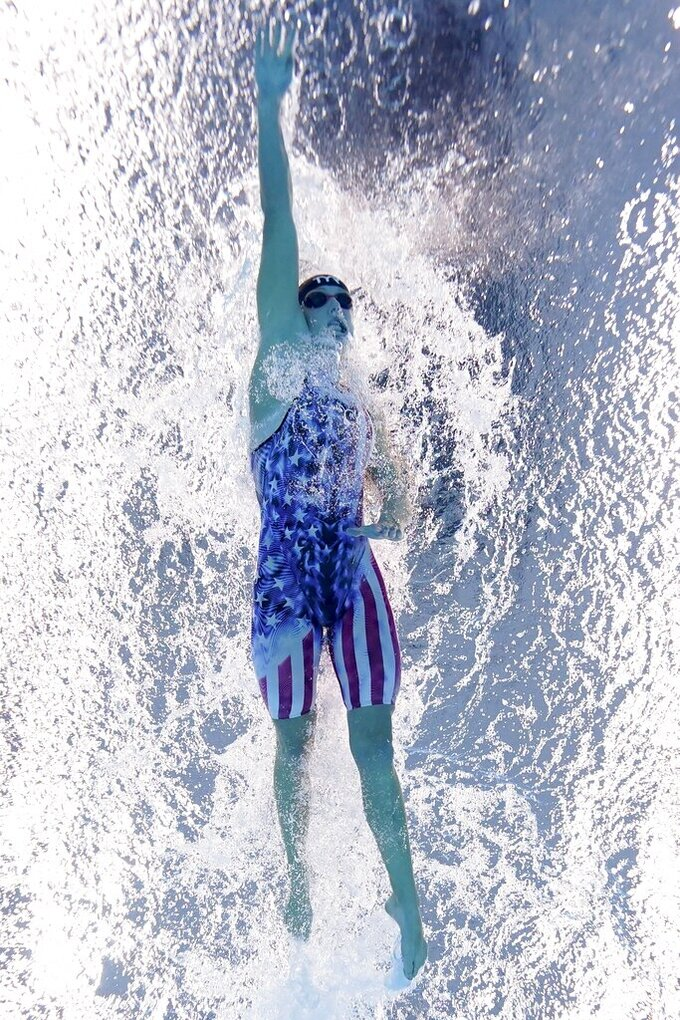 Katie Ledecky of the United States swms the last leg of the women's 4x200-meter freestyle relay team at the 2020 Summer Olympics, Thursday, July 29, 2021, in Tokyo, Japan. (AP Photo/Morry Gash)