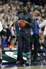 Michigan State's Joshua Langford walks around the court during a practice session for the semifinals of the Final Four NCAA college basketball tournament, Friday, April 5, 2019, in Minneapolis. (AP Photo/David J. Phillip)