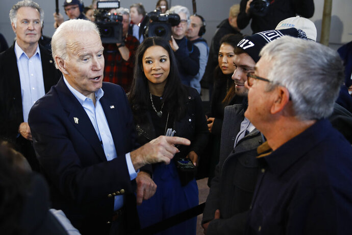 Democratic presidential candidate former Vice President Joe Biden meets with attendees during a campaign event at the University of Northern Iowa, Monday, Jan. 27, 2020, in Cedar Falls, Iowa. (AP Photo/Matt Rourke)