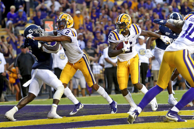 LSU wide receiver Terrace Marshall Jr. (6) catches an 8-yard touchdown against Georgia Southern in the second quarter of an NCAA college football game in Baton Rouge, La., Saturday, Aug. 31, 2019. (AP Photo/Michael Democker)