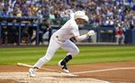 Milwaukee Brewers' Ryan Braun hits an RBI single during the first inning of a baseball game against the Arizona Diamondbacks Friday, Aug. 23, 2019, in Milwaukee. (AP Photo/Morry Gash)