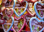 In this Tuesday, Dec. 4, 2018 photo gingerbread hearts are seen at the traditional Christmas market in Heidelberg, Germany, Tuesday. The Christmas market In the Old Town of Heidelberg underneath the famous castle is one of most picturesque christmas markets in southern Germany.  (AP Photo/Michael Probst)