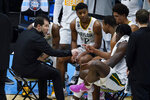 Baylor head coach Scott Drew, left, talks to his team during a timeout in the first half of a men's Final Four NCAA college basketball tournament semifinal game against Houston, Saturday, April 3, 2021, at Lucas Oil Stadium in Indianapolis. (AP Photo/Darron Cummings)