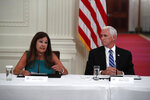 Vice President Mike Pence listens as second lady Karen Pence speaks during a