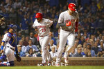 Cincinnati Reds' Christian Colon (29) scores after Curt Casali drew a bases-loaded walk off Chicago Cubs starting pitcher Cole Hamels during the third inning of a baseball game Monday, Sept. 16, 2019, in Chicago. (AP Photo/Charles Rex Arbogast)
