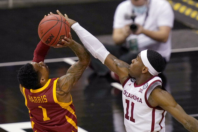 Iowa State guard Tyler Harris (1) shoots while defended by Oklahoma guard De'Vion Harmon (11) during the first half of an NCAA college basketball game in the first round of the Big 12 men's tournament in Kansas City, Mo., Wednesday, March 10, 2021. (AP Photo/Orlin Wagner)