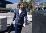 Actor William H. Macy arrives at the federal courthouse in Los Angeles, on Tuesday, March 12, 2019. Macy's wife, actress Felicity Huffman is among fifty people who were charged Tuesday in a scheme in which wealthy parents allegedly bribed college coaches and other insiders to get their children into some of the nation's most elite schools. (AP Photo/Alex Gallardo)