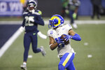 Los Angeles Rams wide receiver Robert Woods, right, heads to the end zone for a touchdown against the Seattle Seahawks during the second half of an NFL wild-card playoff football game, Saturday, Jan. 9, 2021, in Seattle. (AP Photo/Scott Eklund)