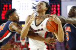 Georgia forward Nicolas Claxton (33) is fouled by Auburn forward Anfernee McLemore (24) and Auburn forward Danjel Purifoy (3) in the first half of an NCAA college basketball game Wednesday, Feb. 27, 2019, in Athens, Ga. (Joshua L. Jones/Athens Banner-Herald via AP)