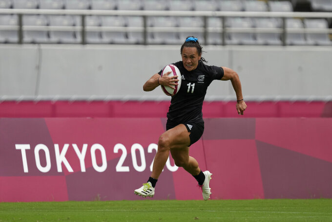 New Zealand's Portia Woodman runs to score a try in New Zealand's women's rugby sevens semifinal match against Fiji at the 2020 Summer Olympics, Saturday, July 31, 2021 in Tokyo, Japan. (AP Photo/Shuji Kajiyama)