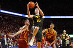 Iowa guard Joe Wieskamp, center, drives to the basket ahead of Iowa State's Michael Jacobson, left, and Tyrese Haliburton (22) during the second half of an NCAA college basketball game, Thursday, Dec. 12, 2019, in Ames, Iowa. (AP Photo/Charlie Neibergall)