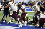 Minnesota running back Mohamed Ibrahim (24) scores a 1-yard touchdown against Georgia Tech during the second half of the Quick Lane Bowl NCAA college football game Wednesday, Dec. 26, 2018, in Detroit. (AP Photo/Carlos Osorio)