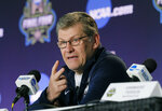 File-This March 30, 2018, file photo shows Connecticut head coach Geno Auriemma talking to the media during a news conference at the women's NCAA Final Four college basketball tournament in Dallas. College basketball season's starting earlier and earlier and that's something top coaches Muffet McGraw and Auriemma aren't thrilled about it. A sport that used to begin practice around Oct. 15 and have its first games at Thanksgiving is now beginning nearly three weeks sooner. Tuesday, Nov. 6, 2018,  will be the first day of games with nearly 100 women's contests scheduled and nearly 150 men's ones as well.(AP Photo/Tony Gutierrez, File)