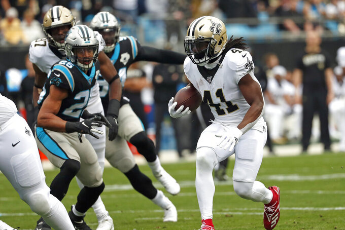 New Orleans Saints running back Alvin Kamara (41) runs against the Carolina Panthers during the first half of an NFL football game in Charlotte, N.C., Sunday, Dec. 29, 2019. Kamara scored a touchdown on the play. (AP Photo/Gerry Broome)