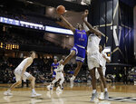 Tennessee State guard Donte Fitzpatrick-Dorsey (3) drives against Vanderbilt forward Simisola Shittu in the first half of an NCAA college basketball game Saturday, Dec. 29, 2018, in Nashville, Tenn. (AP Photo/Mark Humphrey)