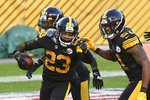 Pittsburgh Steelers cornerback Joe Haden (23) celebrates with teammates in the end zone after intercepting a pass for a touchdown against the Baltimore Ravens during the first half of an NFL football game, Wednesday, Dec. 2, 2020, in Pittsburgh. (AP Photo/Don Wright)