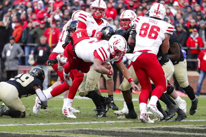 Nebraska quarterback Adrian Martinez (2) dives in for a touchdown against Purdue during the second half of an NCAA college football game in West Lafayette, Ind., Saturday, Nov. 2, 2019. Purdue defeated Nebraska 31-27. (AP Photo/Michael Conroy)