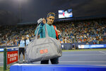 Roger Federer returns to the court at the end of a rain delay in the second set against Juan Ignacio Londero at the Western & Southern Open tennis tournament in Mason, Ohio, Tuesday, Aug. 13, 2019. (Sam Greene/The Cincinnati Enquirer via AP)