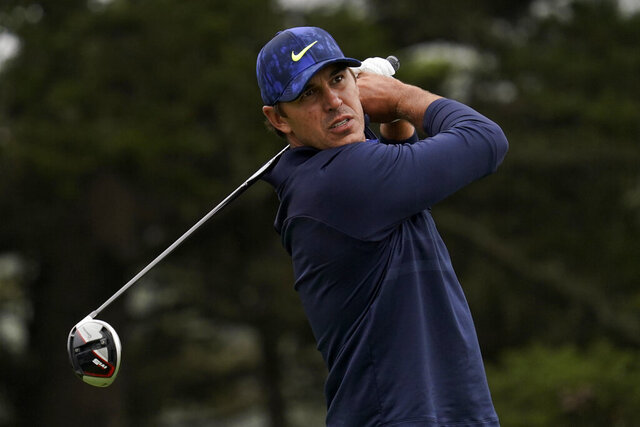 File-This Aug. 8, 2020, file photo shows Brooks Koepka watching his tee shot on the 14th hole during the third round of the PGA Championship golf tournament at TPC Harding Park in San Francisco. Koepka returns to competition this week after missing two months with a hip injury. (AP Photo/Jeff Chiu, File)