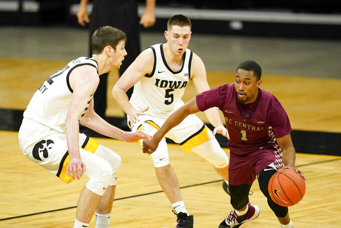 North Carolina Central guard Mike Melvin (1) drives up court around Iowa forward Patrick McCaffery, left, and guard CJ Fredrick (5) during the first half of an NCAA college basketball game, Wednesday, Nov. 25, 2020, in Iowa City, Iowa. (AP Photo/Charlie Neibergall)