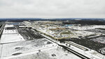 FILE - In this Nov. 28, 2018, file photo, snow covers the perimeter of the General Motors' Lordstown plant, in Lordstown, Ohio. GM employees in Lordstown and other factories in Michigan and Maryland that are targeted to close within a year say moving will force them to leave behind relatives, even their children, in some cases. (AP Photo/John Minchillo, File)
