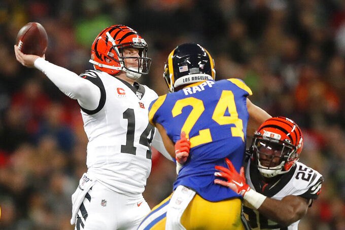 Cincinnati Bengals quarterback Andy Dalton (14) passes against the Los Angeles Rams during the first half of an NFL football game, Sunday, Oct. 27, 2019, at Wembley Stadium in London. (AP Photo/Frank Augstein)