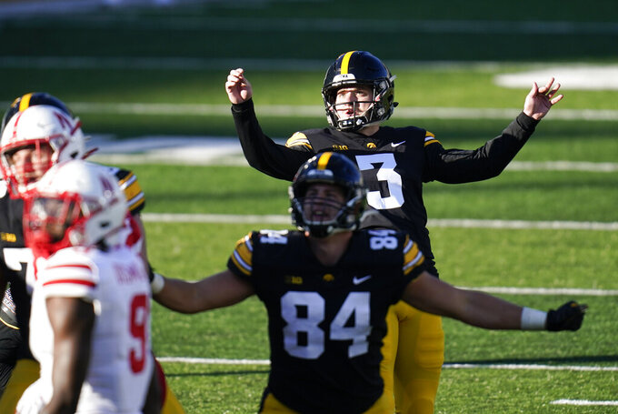 FILE - Iowa place kicker Keith Duncan (3) kicks a 37-yard field goal during the second half of an NCAA college football game against Nebraska in Iowa City, Iowa, in this Friday, Nov. 27, 2020, file photo. Duncan's wild ride of a career is winding down. He was the Hawkeyes' starting kicker as a freshman, didn't kick in a game the next two years and then became a consensus All-American with a record-setting season in 2019. He in all likelihood will make his final appearance at Kinnick Stadium on Saturday when No. 25 Wisconsin visits the 19th-ranked Hawkeyes. (AP Photo/Charlie Neibergall, File)