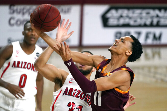 Arizona State guard Alonzo Verge Jr. (11) drives past Arizona guard Terrell Brown Jr. during the first half of an NCAA college basketball game Thursday, Jan. 21, 2021, in Tempe, Ariz. (AP Photo/Rick Scuteri)