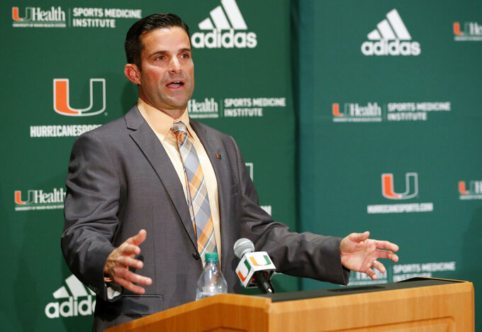FILE - In this Wednesday, Jan. 2, 2019 file photo, Manny Diaz speaks during a news conference after being named Miami's new NCAA college football head coach in Coral Gables, Fla. Florida State and Miami were hoping signing day could help put to the negativity of 2018 to rest and provide a push toward better times. Miami, coming off a 7-6 season and coach Mark Richt's surprising retirement, managed to finally provide some good news for Hurricanes fans. New coach Manny Diaz bolstered the 'Canes recruiting class with some high-profile transfers. (AP Photo/Wilfredo Lee, File)