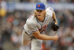 New York Mets pitcher Noah Syndergaard works against the San Francisco Giants in the first inning of a baseball game Thursday, July 18, 2019, in San Francisco. (AP Photo/Ben Margot)