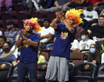 Connecticut Sun fans, wearing face masks and wigs, cheer during the team's WNBA basketball game against the Minnesota Lynx on Tuesday, Aug. 17, 2021, in Uncasville, Conn. (Sarah Gordon/The Day via AP)
