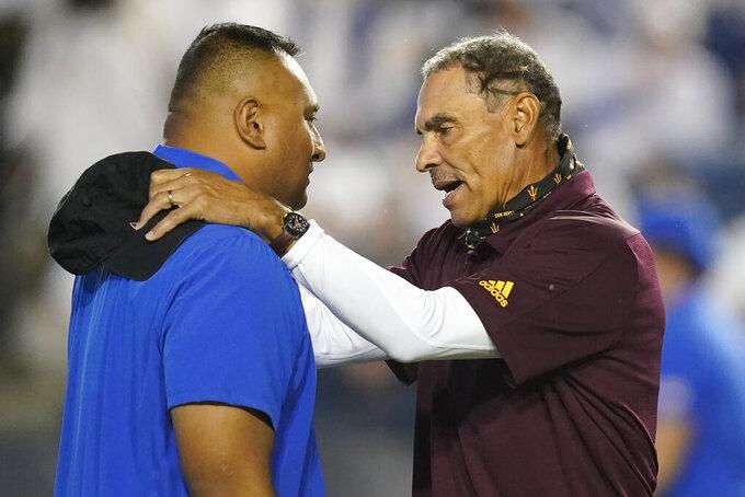 BYU coach Kalani Sitake, left, and Arizona State coach Herm Edwards speak before an NCAA college football game Saturday, Sept. 18, 2021, in Provo, Utah. (AP Photo/Rick Bowmer)